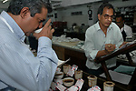 A tea tester and his assitant at work in the tea testing room of J. Thomas ltd. company in Kolkata, West Bengal,  India,  Arindam Mukherjee