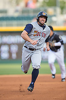 Tyler Collins (18) of the Toledo Mud Hens hustles towards third base against the Charlotte Knights at BB&T BallPark on April 27, 2015 in Charlotte, North Carolina.  The Knights defeated the Mud Hens 7-6 in 10 innings.   (Brian Westerholt/Four Seam Images)