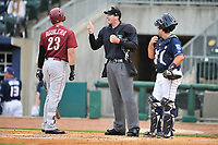 Home plate umpire Nate Tomlinson explains a call to Eric Aguilera (23) of the Frisco RoughRiders as Northwest Arkansas Naturals catcher Allan de San Miguel (11) looks on at Arvest Ballpark on May 23, 2017 in Springdale, Arkansas.  The RoughRiders defeated the Naturals 7-6 in the completion of the game suspended on May 23, 2017.  (Dennis Hubbard/Four Seam Images)