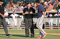 Umpire Tyler Jones discusses a call during the game between the Mississippi Braves and the Tennessee Smokies at Smokies Stadium on July 15, 2021, in Kodak, Tennessee. (Danny Parker/Four Seam Images)
