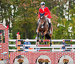 Boyd Martin and Ying Yang Yo clear the third fence during Stadium Jumping at the Dansko Fair Hill International 3-Day Event in Fair Hill, Maryland on October 16, 2011. Martin's round secured his second win in three years at Fair Hill.
