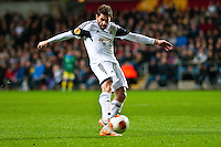 Swansea, UK. Thursday 20 February 2014<br /> Pictured: Angel Rangel takes a shot at goal<br /> Re: UEFA Europa League, Swansea City FC v SSC Napoli at the Liberty Stadium, south Wales, UK