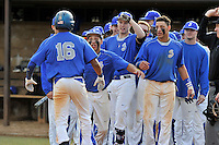 Center fielder Dominique Jackson (16) of the Spartanburg Methodist College Pioneers is congratulated after hitting a home run in a junior college game against Surry Community College on January 31, 2016, at Mooneyham Field in Spartanburg, South Carolina. (Tom Priddy/Four Seam Images)