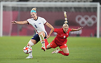 KASHIMA, JAPAN - AUGUST 2: Julie Ertz #8 of the United States battles for the ball with Adriana Leon #9 of Canada during a game between Canada and USWNT at Kashima Soccer Stadium on August 2, 2021 in Kashima, Japan.