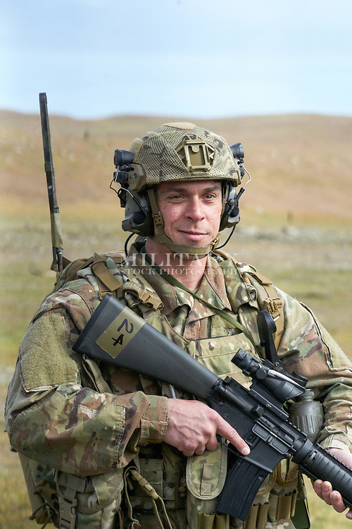 STOCK PHOTOGRAPH Model Released DoD Compliant<br /> Soldier in US Army uniform with combat equipment and rifle, Team Wendy EXFIL helmet, binoculars.