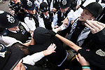 © Joel Goodman - 07973 332324 . 30/06/2011 . London , UK . Police scuffle with protesters in Westminster . Tens of thousands of public sector workers demonstrate and march through the City of London in protest at proposed changes to their pensions . Photo credit : Joel Goodman