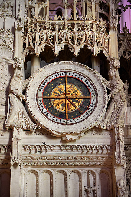 16th century flamboyant gothic Astrological Clock in the choir screen  of the Cathedral of Chartres, France. A UNESCO World Heritage Site. The chancel screen includes, on the south side, an impressive astrological clock dating from the 16th century. It told not only the time but the day of the week, the month of the year, the time of sunrise and sunset, the phase of the moon and the current sign of the zodiac. Its inner works were partially destroyed in 1793.