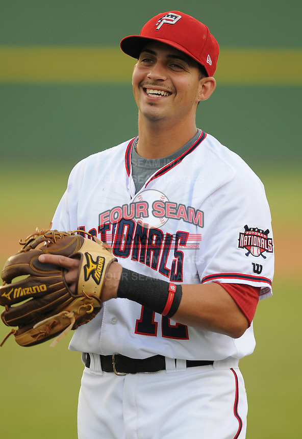 Infielder Jose Lozada (12) of the Potomac Nationals, Carolina League affiliate of the Washington Nationals, prior to a game against the Salem Red Sox on June 16, 2011, at Pfitzner Stadium in Woodbridge, Va. Photo by Tom Priddy / Four Seam Images