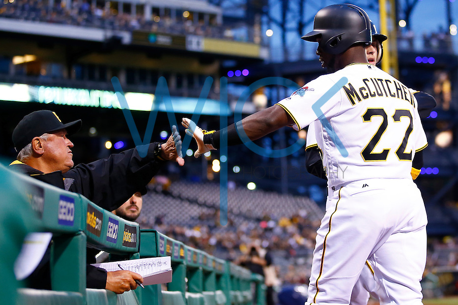 Andrew McCutchen #22 of the Pittsburgh Pirates is congratulated by manager Clint Hurdle #13 of the Pittsburgh Pirates after scoring against the St. Louis Cardinals during the game at PNC Park in Pittsburgh, Pennsylvania on April 6, 2016. (Photo by Jared Wickerham / DKPS)
