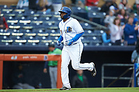 Dashenko Ricardo (30) of the Durham Bulls jogs towards home plate after hitting a home run against the Gwinnett Braves at Durham Bulls Athletic Park on April 20, 2019 in Durham, North Carolina. The Bulls defeated the Braves 11-3 in game one of a double-header. (Brian Westerholt/Four Seam Images)
