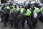 """© Joel Goodman - 07973 332324 . 26/03/2011 . London , UK . Protesters and riot police clash near Oxford Circus . Hundreds of thousands of people attend an anti cuts demonstration under the banner """" March for the Alternative """" in central London , in protest at the coalition government's austerity measures . Photo credit : Joel Goodman"""