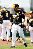 Charlie Lowell (41) of the Wichita State Shockers walks towards the dugout after being taken out during a game against the Missouri State Bears on April 9, 2011 at Hammons Field in Springfield, Missouri.  Photo By David Welker/Four Seam Images