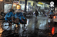 Bikers under heavy rain by night (Licence this image exclusively with Getty: http://www.gettyimages.com/detail/83154163 )