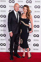 (L-R) Patrick Stewart and Sunny Ozell arrive for the GQ Men Of The Year Awards 2016 at the Tate Modern, London