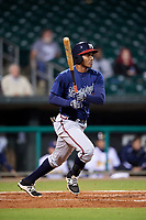 Mississippi Braves designated hitter Carlos Franco (13) follows through on a swing during a game against the Montgomery Biscuits on April 24, 2017 at Montgomery Riverwalk Stadium in Montgomery, Alabama.  Montgomery defeated Mississippi 3-2.  (Mike Janes/Four Seam Images)