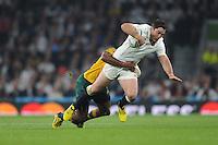 Brad Barritt of England is tackled by Tevita Kuridrani of Australia during Match 26 of the Rugby World Cup 2015 between England and Australia - 03/10/2015 - Twickenham Stadium, London<br /> Mandatory Credit: Rob Munro/Stewart Communications