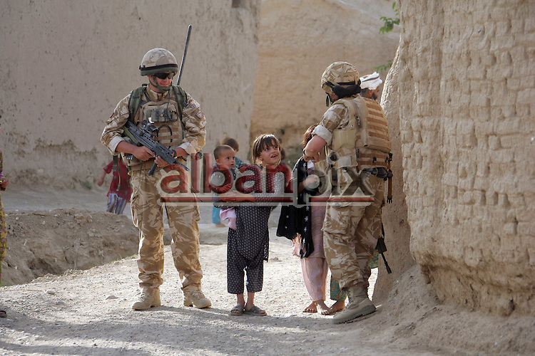 RAF Regiment.patrol the  Village of  Molla Abdullah Kariz, Kandahar province..The Taliban plotted  to kill dozens on innocent Afghan children on their first day at school at Molla Abdullah Kariz