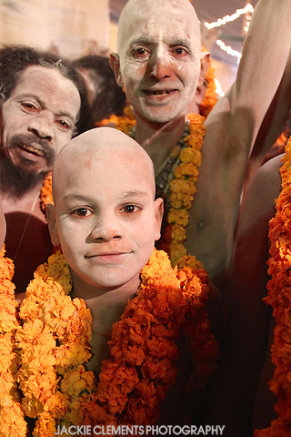 Occasionally a  young boy appears in the crowds of older Naga sadhus.