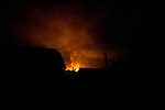 UKRAINE, Pisky: A shelling nearby the rear base put a another rear base of Pisky on fire late at night.