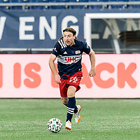 FOXBOROUGH, MA - OCTOBER 3: Tommy McNamara #26 of New England Revolution brings the ball forward during a game between Nashville SC and New England Revolution at Gillette Stadium on October 3, 2020 in Foxborough, Massachusetts.