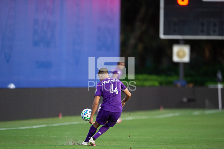 LAKE BUENA VISTA, FL - JULY 25: Joao Moutinho #4 of Orlando City SC kicks the ball during a game between Montreal Impact and Orlando City SC at ESPN Wide World of Sports on July 25, 2020 in Lake Buena Vista, Florida.