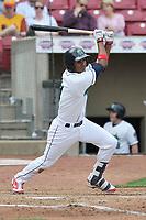 Cedar Rapids Kernels shortstop Jermaine Palacios (4) swings during a game against the Beloit Snappers at Veterans Memorial Stadium on April 9, 2017 in Cedar Rapids, Iowa.  The Kernels won 6-1.  (Dennis Hubbard/Four Seam Images)