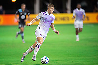 LAKE BUENA VISTA, FL - AUGUST 06: Chris Mueller #9 of Orlando City SC dribbles the ball during a game between Orlando City SC and Minnesota United FC at ESPN Wide World of Sports on August 06, 2020 in Lake Buena Vista, Florida.