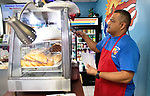 WATERBURY CT. - 27 December 2019-1227SV04-Pedro Ocasio, owner, serves empanada at his restaurant La Borinquena on South Main Street in Waterbury Friday.<br /> Steven Valenti Republican-American