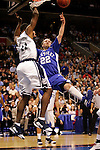 Kentucky guard Patrick Sparks (22) drives to the basket over Connecticut center Hilton Armstrong (11).  Connecticut defeated Kentucky 87-83 in the second round of the NCAA Tournament  at the Wachovia Center in Philadelphia, Pennsylvania on March 19, 2006.