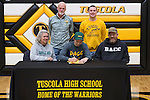 February 3, 2017- Tuscola, IL- Tuscola Warrior Cross Country's Trent Ponder signs his letter of intent to compete for the Danville Area Community College Jaguars. Standing from left are DACC coach Jim Acklin and Warrior coach Dustin Dees. Seated from left are mother Brinda Ponder, Trent Ponder, and father Hugh Ponder. [Photo: Douglas Cottle]