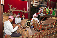 Myanmar, Burma. Bagan.  Burmese Musicians, Marionettes in Background.