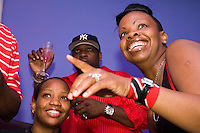 Trinidad and Tobago fans cheer on their team during their World Cup match against England on June 15, 2006 at Reign, a New York City nightclub.<br /> <br /> The World Cup, held every four years in different locales, is the world's pre-eminent sports tournament in the world's most popular sport, soccer (or football, as most of the world calls it).  Qualification for the World Cup is open to any country with a national team accredited by FIFA, world soccer's governing body. The first World Cup, organized by FIFA in response to the popularity of the first Olympic Games' soccer tournaments, was held in 1930 in Uruguay and was participated in by 13 nations.    <br /> <br /> As of 2010 there are 208 such teams.  The final field of the World Cup is narrowed down to 32 national teams in the three years preceding the tournament, with each region of the world allotted a specific number of spots.  <br /> <br /> The World Cup is the most widely regularly watched event in the world, with soccer teams being a source of national pride.  In most nations, the whole country is at a standstill when their team is playing in the tournament, everyone's eyes glued to their televisions or their ears to the radio, to see if their team will prevail.  While the United States in general is a conspicuous exception to the grip of World Cup fever there is one city that is a rather large exception to that rule.  In New York City, the most diverse city in a nation of immigrants, the melting pot that is America is on full display as fans of all nations gather in all possible venues to watch their teams and celebrate where they have come from.