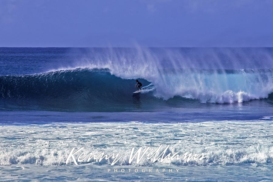 Surfer Going Backdoor at Banzai Pipeline, Enukai Beach Park, Oahu, Hawaii, USA.