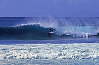 Surfer Going Backdoor at Banzai Pipeline, Enukai Beach Park, Oahu, Hawaii, USA.