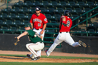 Greensboro Grasshoppers first baseman Austen Smith (18) can't handle a low throw as Jose Cardona (8) of the Hickory Crawdads lunges for the base at L.P. Frans Stadium on May 6, 2015 in Hickory, North Carolina.  The Crawdads defeated the Grasshoppers 1-0.  (Brian Westerholt/Four Seam Images)
