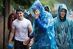 © Joel Goodman - 07973 332324 . 11/06/2016 . Manchester , UK . Revellers arrive at the festival in a heavy downpour . Parklife music festival at Heaton Park in Manchester . Photo credit : Joel Goodman