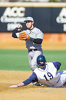 Marshall Thundering Herd second baseman Andrew Dundon (14) attempts to turn a double play against the Georgetown Hoyas at Wake Forest Baseball Park on February 15, 2014 in Winston-Salem, North Carolina.  The Thundering Herd defeated the Hoyas 5-1.  (Brian Westerholt/Four Seam Images)