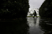 A member of the United States Secret Service walks in front of the White House in a light rain on June 11, 2020 in Washington, DC.<br /> Credit: Oliver Contreras / Pool via CNP/AdMedia