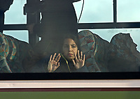 """A young Palestinian girl holds a toy and a pastry as he looks from the window of a coach bound to cross the Erez checkpoint from the northern Gaza Strip, 02 December 2007, into Israel on its way to Egypt. Israel today allowed more than 250 Palestinians from the Hamas-run Gaza Strip to cross into Egypt via Israeli territory for the first time in months, witnesses and officials said. """"photo by Fady Adwan"""""""