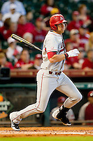 Derrick Bleeker #9 of the Arkansas Razorbacks follows through on his swing against the Houston Cougars at Minute Maid Park on March 3, 2012 in Houston, Texas.  The Cougars defeated the Razorbacks 4-1.  (Brian Westerholt/Four Seam Images)