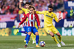 Antoine Griezmann of Atletico de Madrid (L) fights for the ball with Mateo Pablo of Villarreal (R) during the La Liga match between Atletico de Madrid vs Villarreal CF at the Estadio Vicente Calderon on 25 April 2017 in Madrid, Spain. Photo by Diego Gonzalez Souto / Power Sport Images