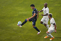 SAN JOSE, CA - SEPTEMBER 5: Andy Rios #25 of the San Jose Earthquakes plays the ball under pressure from Collen Warner #32 of the Colorado Rapids during a game between Colorado Rapids and San Jose Earthquakes at Earthquakes Stadium on September 5, 2020 in San Jose, California.