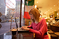 Montreal (Qc) CANADA ,  Nov 2008 -<br /> Model Released illustration photo -<br /> <br />  18) lows03009 teen on wireless laptop in free internet coffee shop environment.