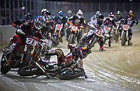 The leader crashes at the front of the pack during a short track motorcycle race at Daytona Flat Track, Daytona Beach, FL, March 3, 2010.  (Photo by Brian Cleary/www.bcpix.com)