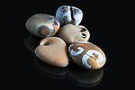 Still life of miscellaneous small rocks found beachcombing in the Pacific Northwest.