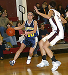 WATERBURY, CT,  02 JANUARY 2006, 010207BZ12-  Kennedy's Marjorie Oliveira (10) drives the lane against Sacred Heart's Bianca Lucky (24) during their game at Sacred Heart High School in Waterbury Tuesday.<br /> Jamison C. Bazinet Republican-American