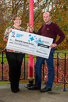 Pictured: David and Lynne Price with a cheque for one million pounds at Bedwellty House,Tredegar, Blaenau Gwent, Wales, UK. Tuesday 12 November 2019<br /> Re: David Price from New Tredegar is the latest winner from Wales to join the Millionaire club just a week before The National Lottery marks 25 years since its first draw. David, 53, who loves the great outdoors, will use part of his windfall to put towards a dream trip to Mount Everest Base Camp next year.