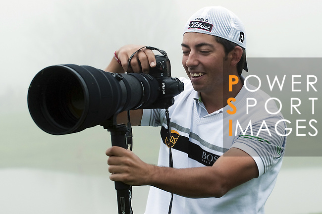 JEJU, SOUTH KOREA - APRIL 21:  Pablo Larrazabal of Spain plays with a professional Nikon camera during the pro - am of the Ballantine's Championship at Pinx Golf Club on April 21, 2010 in Jeju island, South Korea.  Photo by Victor Fraile / The Power of Sport Images