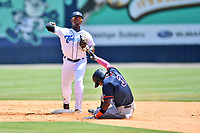 Asheville Tourists Freudis Nova (7) makes the turn on the front end of a double play over a hard sliding Osmy Gregorio (3) during a game against the Bowling Green Hot Rods on May 30, 2021 at McCormick Field in Asheville, NC. (Tony Farlow/Four Seam Images)