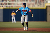 Bryan Arias (28) of the Guerreros de Fayetteville takes his lead off of first base against the Rapidos de Kannapolis at Atrium Health Ballpark on June 24, 2021 in Kannapolis, North Carolina. (Brian Westerholt/Four Seam Images)